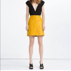 Zara faux leather a-line mustard skirt.